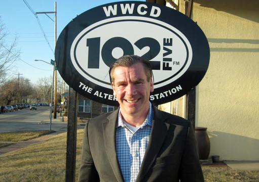 Randy Malloy stands in front of the radio station he manages: CD102.5. Credit: Courtesy of Randy Malloy