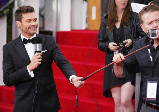 Ryan Seacrest gets his selfie video camera adjusted on the red carpet at the 72nd Annual Golden Globe Awards show at the Beverly Hilton Hotel in Beverly Hills, Calif., on Sunday, Jan. 11, 2015. Credit: Courtesy of TNS.