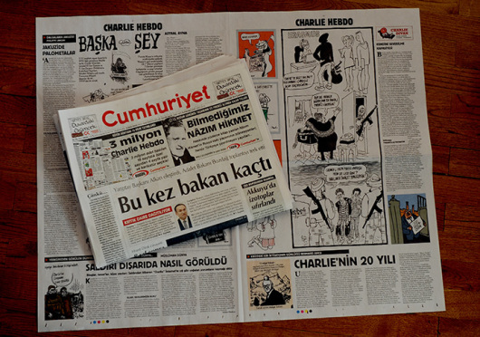 Turkish Newspaper Cumhuriyet printed a four-page selection of cartoons and articles on Wednesday in a show of solidarity with Charlie Hebdo but left out cartoons which Muslims may find offensive. However, two Cumhuriyet columnists Hikmet Cetinkaya and Ceyda Karan used small, black-and-white images of the Charlie Hebdo cover as their column headers in Wednesday's issue. Ankara, Turkey, January 14, 2015. Credit: Courtesy of TNS