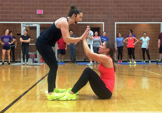 Alice Adams (left) and Stephanne Musser co-teach the Nike Fitness Training Club class Jan. 28 at the RPAC. The RPAC is the only location on campus to offer the class. Credit: Lee McClory / Design editor