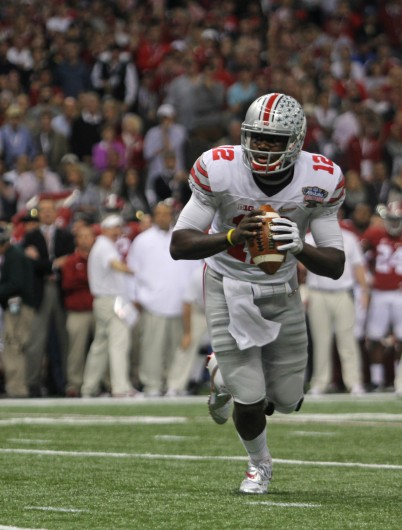 OSU redshirt-sophomore quarterback Cardale Jones (12) looks to his teammates before attempting a pass during the 2015 Allstate Sugar Bowl against Alabama on Jan. 1 in New Orleans. OSU won, 42-35.  Credit: Chelsea Spears / Multimedia editor