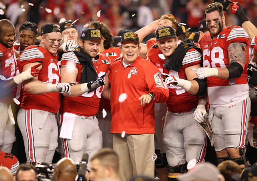Co-offensive coordinator and offensive line coach Ed Warinner (center) poses with members of the OSU offensive line after the 2015 College Football Playoff National Championship against Oregon on Jan. 12 in Arlington, Texas. OSU won, 42-20. Credit: Mark Batke / Photo editor