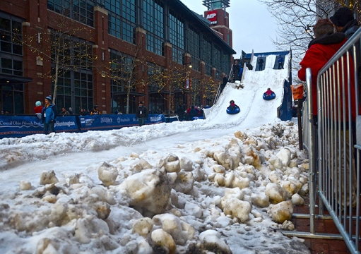 Children take a ride on a snow slide Jan. 24 at All-Star Winter Park in downtown Columbus. The slide was part of numerous festivities taking place around Nationwide Arena during the NHL All-Star Game weekend. Credit: Kevin Stankiewicz / Lantern reporter