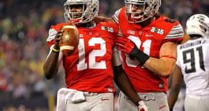 Redshirt-sophomore quarterback Cardale Jones (12) celebrates with redshirt-junior tight end Nick Vannett (81) during the College Football Playoff Championship against Oregon on Jan. 12 in Arlington, Texas. OSU won, 42-20.  Credit: Mark Batke / Photo editor