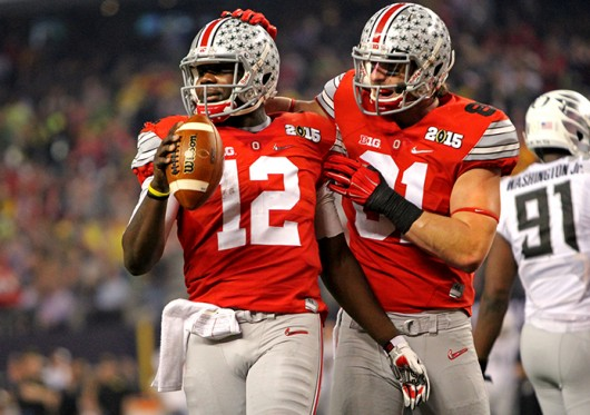 Then-redshirt sophomore quarterback Cardale Jones (12) celebrates with redshirt-junior tight end Nick Vannett (81) during the College Football Playoff Championship against Oregon on Jan. 12 in Arlington, Texas. OSU won, 42-20.  Credit: Lantern file photo