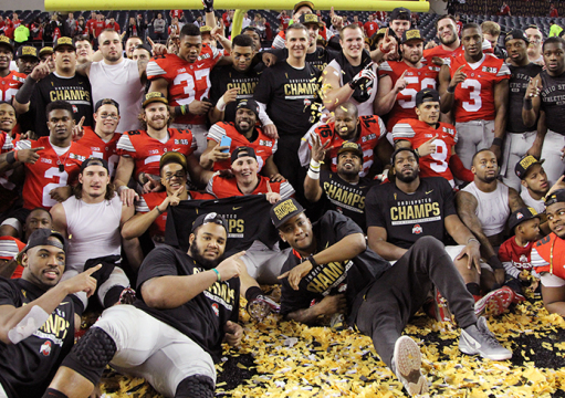 OSU players and coaches pose on the field at AT&T Stadium after the 2015 College Football Playoff National Championship against Oregon on Jan. 12 in Arlington, Texas. OSU won, 42-20. Credit: Mark Batke / Photo editor
