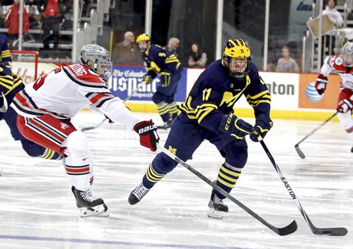 Michigan senior forward Zach Hyman (11) skates by OSU freshman defender Victor Björkung (5) in a Jan. 19 game at the Schottenstein Center. OSU lost 10-6. Credit: Kelly Roderick / Lantern photographer