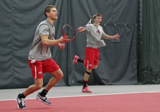 Junior Kevin Metka and Senior Peter Kobelt play in a match against Texas A&M on Sunday, Feb. 09 at the Varsity Tennis Center. OSU won, 4-3. Credit: Lantern file photo