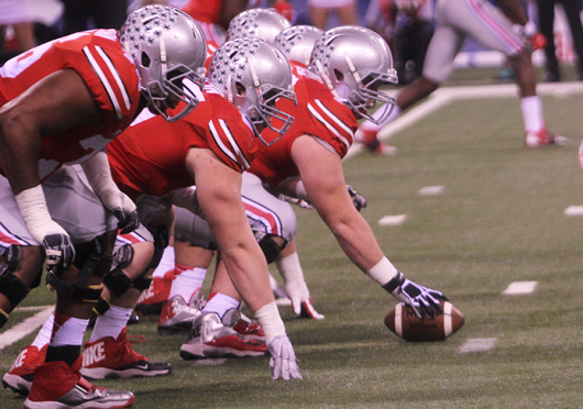 Members of the OSU offensive line prepare for a snap during a game against Wisconsin on Dec. 6 in Indianapolis. OSU won, 56-0.  Credit: Chelsea Spears / Multimedia editor