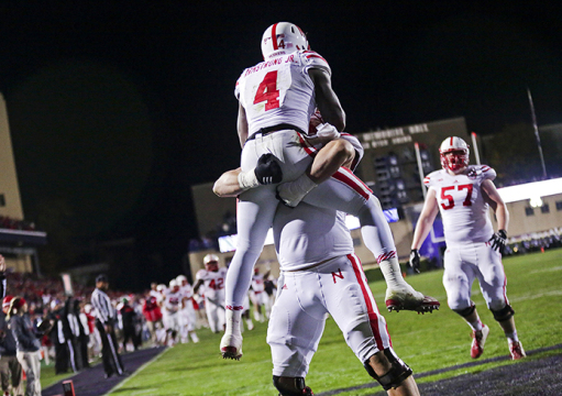 Nebraska Cornhuskers offensive lineman Jake Cotton (68) picks up Nebraska Cornhuskers quarterback Tommy Armstrong Jr. (4) after scoring a touchdown against Northwestern during the first quarter at Ryan Field Oct. 18, 2014, in Evanston, Ill. (Armando L. Sanchez/Chicago Tribune/MCT)