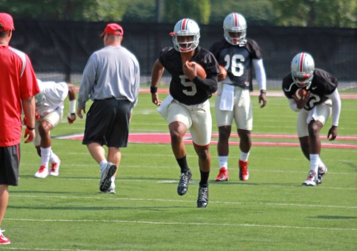 Senior quarterback Braxton Miller (5), redshirt-freshman quarterback J.T. Barrett (16) and redshirt-sophomore quarterback Cardale Jones (12) warm up during fall camp at the Woody Hayes Athletic Center. Credit: Tim Moody / Sports editor