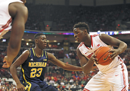 Freshman forward Jae'Sean Tate holds the ball as Michigan junior guard Caris LeVert defends during a Jan. 13 game at the Schottenstein Center. OSU won, 71-52. Credit: Kelly Roderick / Lantern photographer