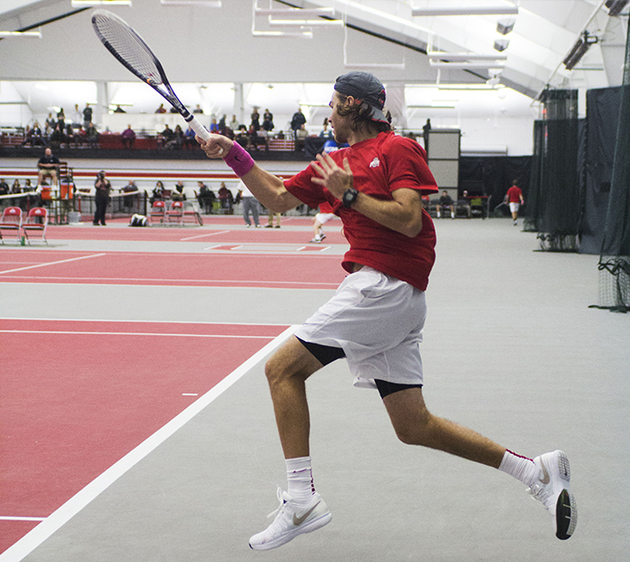 Redshirt-senior Hunter Callahan hits the ball during a match against Xavier on Jan. 21 at the Varsity Tennis Center. OSU won, 7-0. Credit: Judy Won / Lantern reporter