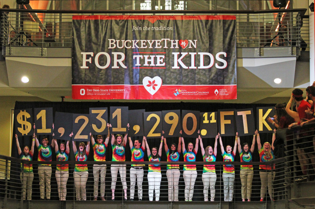 Students reveal BuckeyeThon's total fundraised amount of more than $1.23 million during the annual dance marathon's closing ceremonies on Feb. 7 at the Ohio Union. The total shattered the organization's goal of $1 million to donate toward fighting pediatric cancer at Nationwide Children's Hospital. Credit: Mark Batke / Photo editor
