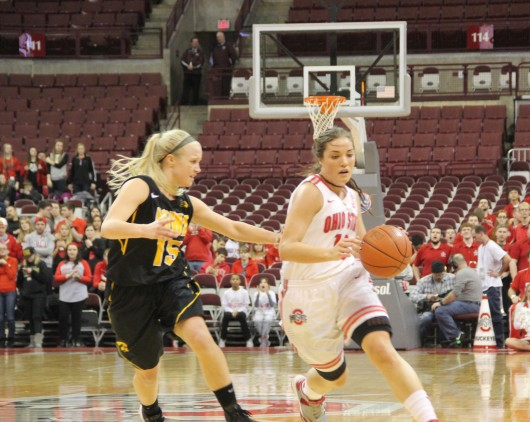 OSU then-junior guard Cait Craft attempts to drive past Iowa freshman guard Whitney Jennings during a game on Feb. 21 at the Schottenstein Center. OSU won, 100-82. Credit: Lantern File Photo