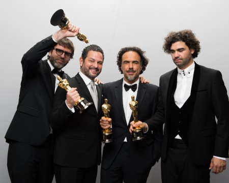 Nicolaas Giacobone, Alejandro G. Inarritu, Alexander Dinelaris, Jr. and Armando Bo pose backstage with the Oscar for Original screenplay, for work on ''Birdman or (The Unexpected Virtue of Ignorance)'' during the live ABC Telecast of The 87th Oscars at the Dolby Theatre in Hollywood. Credit: Courtesy of TNS.