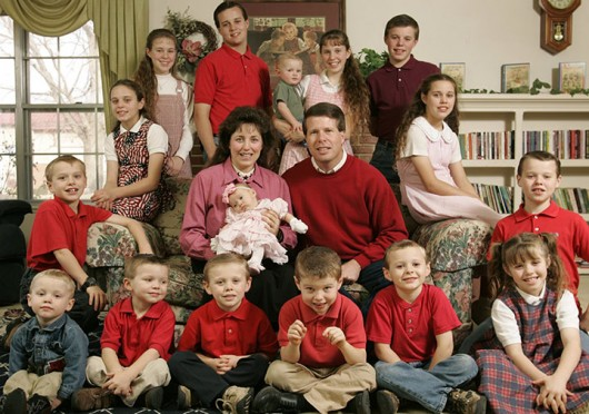 Jim Bob, 40, center right, and Michelle Duggar, 39, center left, pose for family portrait with their 16 biological children, ten boys, and six girls, at their family home in Springdale, Arkansas, December 14, 2005.  Credit: Courtesy of TNS