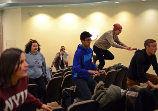 Members of Fishbowl Improv during a warmup exercise at their practice on Tuesday, February 18 in University Hall. Fishbowl Improv will be hosting The Tides improv festival this Friday and Saturday at the Ohio Union. Credit: Sallee Ann Ruibal / Lantern photographer