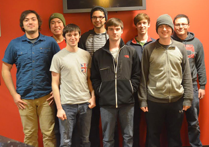 Ohio State's 'League of Legends' team. From left to right (alternating front and back rows), it's Stephen Vernyi, Kentaro Ogawa, Oliver Mills, Richard Flagg, Peter Ferguson, Cramer Tritt, Colin O'Brien, and Gerald Richland.  Credit: Robert Scarpinito / Lantern reporter