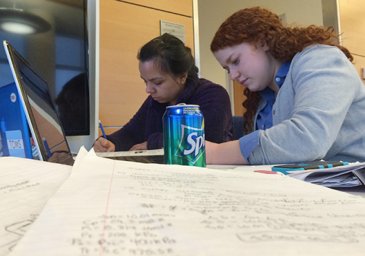 Lauren Kiren (left) and Angela Lawver, third-year chemical engineering students, do homework on Feb. 16 inside OSU's CBEC building. The building opened to students and faculty in January. Credit: Lee McClory / Design editor