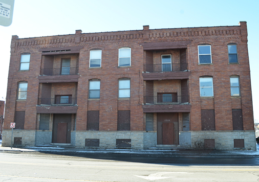 Abandoned apartment buildings, such as the one pictured on the corner of North High Street and 9th Avenue, are scheduled to undergo renovations.  Credit: Robert Scarpinito / Lantern reporter