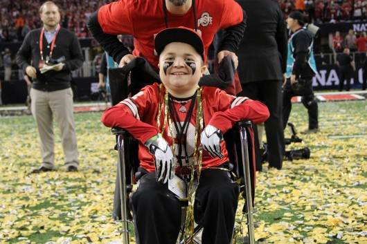 Jacob Jarvis poses on the field after the College Football Playoff National Championship game on Jan. 12 in Arlington, Texas. OSU defeated Oregon, 42-20. Credit: Mark Batke / Photo editor