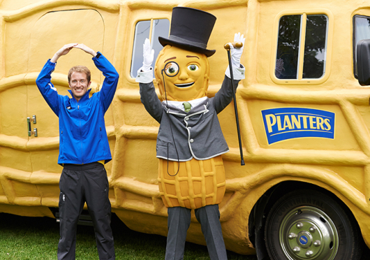 OSU alumnus Tom Shepherd poses with Mr. Peanut in front of the Planters NUTmobile. Credit: Courtesy of Kraft Foods Group