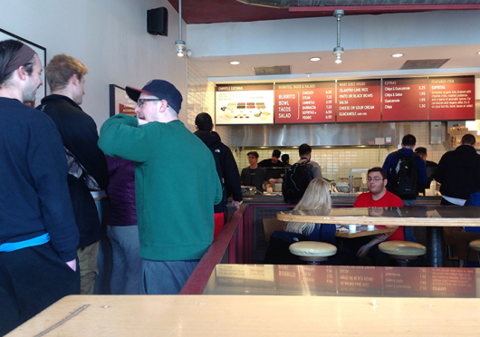 People stand in line at Chipotle, located at 1726 N. High St. Credit: Alaina Bartel / Lantern reporter
