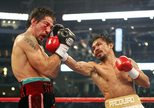 Manny Pacquiao (right) is set to fight the undefeated Floyd Mayweather for the first time on May 2. Credit: Courtesy of TNS