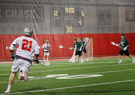 Senior midfielder Rick Lewis (21) runs toward the goal during a game against Dartmouth on Feb. 21 in Columbus. OSU won, 15-5. Credit: Molly Tavoletti / Lantern reporter