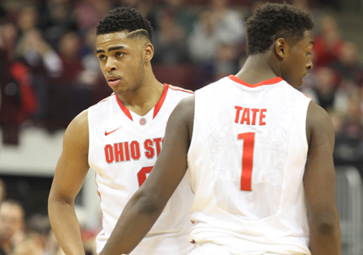 Freshman guard D'Angelo Russell (left) and freshman forward Jae'Sean Tate pause during a timeout during a game against Maryland on Jan. 29 at the Schottenstein Center. OSU won, 80-56.  Credit: Samantha Hollingshead / Lantern photographer