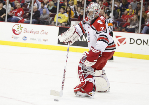 Sophomore goalkeeper Matt Tomkins (31) fields the puck during a game against Michigan on Jan. 16 at the Schottenstein Center. OSU lost, 10-6. Credit: Kelly Roderick / Lantern photographer