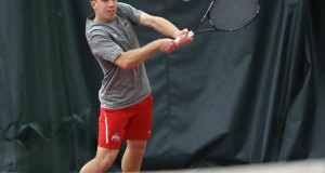 Redshirt-junior Chris Diaz prepares to hit the ball during a match against South Florida on Feb. 8 in Columbus. OSU won, 4-0. Credit: Mark Batke / Photo editor