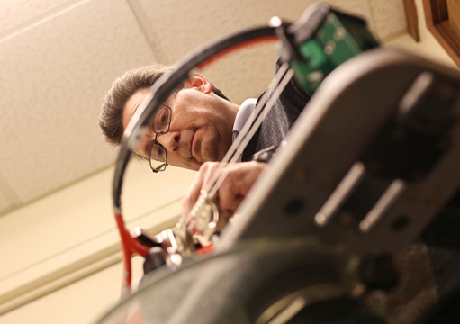Jeff Deibel, in his 35th year of stringing racquets for the OSU men's and women's tennis teams, is on call for the Buckeyes 24/7.  Credit: Mark Batke / Photo editor