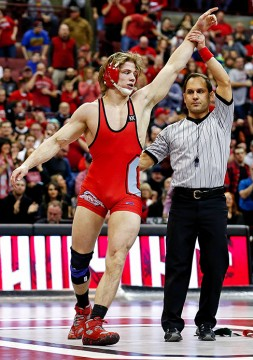 Redshirt-freshman Bo Jordan is awarded a victory during a dual meet against Minnesota on Feb. 6 at the Schottenstein Center. OSU won, 22-13. Credit: Courtesy of TNS