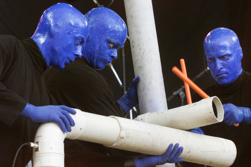 Members of the Blue Man Group play unique instruments made from plastic pipes, flexible poles and other unusual objects. Credit: Courtesy of TNS