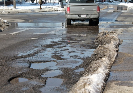 26,791 potholes from Nov. 1, 2014 to Feb. 25, 2015 have been mended by the Columbus Public Service Department. Student's can call 311 to report locations with potholes. Credit: Karlie Frank / Lantern photographer