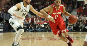 Then-OSU freshman guard D'Angelo Russell drives to the basket during a game against Michigan State  in the Big Ten Tournament on Mar. 13 at the United Center. OSU lost 76-67. Credit: Lantern file photo