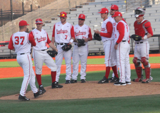 Members of the OSU baseball team gather on the pitcher's mound to meet during a game against Akron on March 25 at Bill Davis Stadium. OSU won, 9-4. Credit: Ethan Scheck / Lantern photographer
