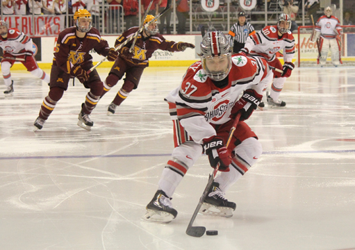 Sophomore forward Nick Schilkey (37) controls the puck during a game against Minnesota on March 6 at the Schottenstein Center. OSU lost, 4-2. Credit: Kaley Rentz / Lantern reporter