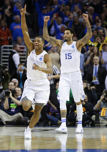 Kentucky's Aaron Harrison (left) and Willie Cauley-Stein (15) celebrate at the end in a 68-66 win against Notre Dame in the NCAA Tournament's Elite 8 on March 28 in Cleveland. Credit: Courtesy of TNS