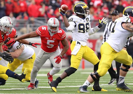Then-freshman linebacker Raekwon McMillian (5) closes in on Michigan then-redshirt-senior quarterback Devin Gardner (98) during a game on November 29 at Ohio Stadium. OSU won, 42-28. Credit: Mark Batke / Photo editor