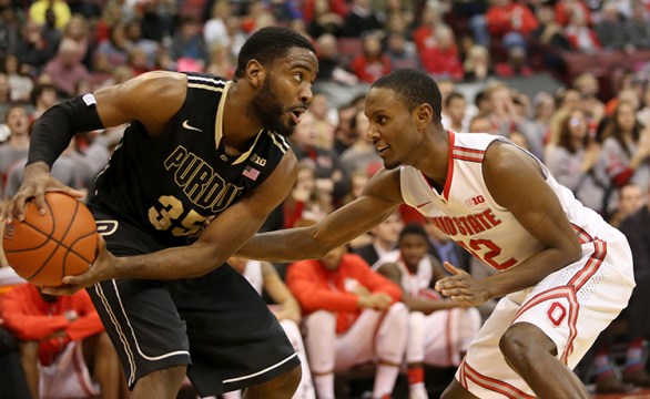 Purdue junior guard Rapheal Davis (35) protects the ball from OSU senior forward Sam Thompson (12) during a March 1 game at the Schottenstein Center. OSU won, 65-61.  Credit: Mark Batke / Photo editor