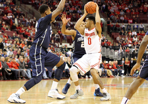 Freshman guard D'Angelo Russell (0) is pressured by Penn State players during a game on Feb. 11 at the Schottenstein Center. OSU won, 75-55. Credit: Samantha Hollingshead / Lantern photographer