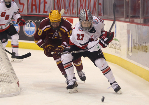 Minnesota senior defenseman Ben Marshall (10) and OSU sophomore forward Nick Schilkey (37) compete for possession during a March 7 game at the Schottenstein Center. OSU won, 5-2.  Credit: Mark Batke / Photo editor