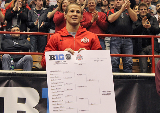 Redshirt-senior Logan Stieber smiles as he is named 2015 Big Ten Champion on March 8 at St. John Arena. Stieber became the first-ever OSU wrestler to win the title 4 times.  Credit: Patrick Kalista / Lantern reporter