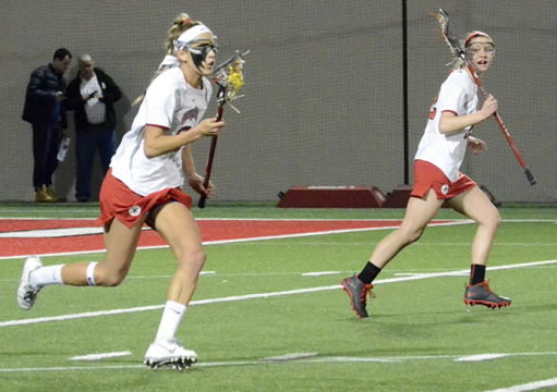 Senior defender Taylor Donahue (left) streaks up the field during a game against Niagra on March 1 in Columbus. OSU won, 15-2. Credit: Leah Alexander / Lantern photographer