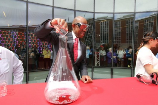 In place of a ribbon cutting ceremony, the CBEC opening celebration ended with a science experiment. OSU President Michael Drake helped to create the exothermic reaction that resulted in four foam-like eruptions and a hearty applause from attendees. Credit: Yann Schreiber / Lantern reporter