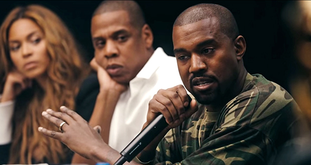 Kanye West (right) talks during a Tidal launch meeting. Credit: Screenshot of Tidal advertisement