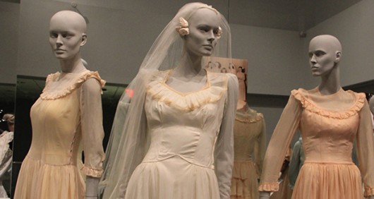 "Three of the dresses on display at ""And the Bride Wore..."" on display through May 9 in Campbell Hall 175. Credit: Eileen McClory / Design Editor"